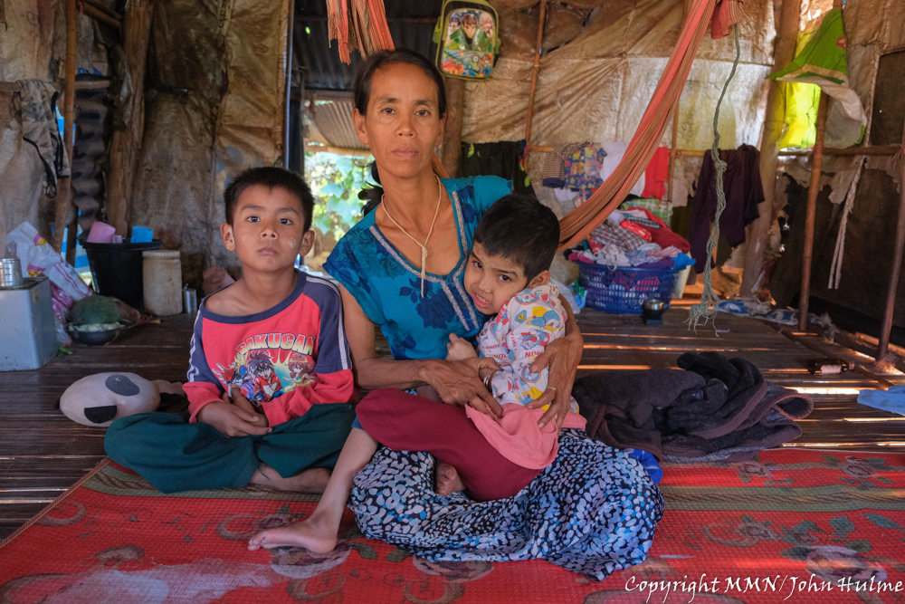 "Ma Phyu is a single mom of four children; her husband died when her youngest child was just 6 months old. Ma Phyu and her children crossed the border into Thailand in hope of working to save enough money to enable them to eventually return home to a better life and more stability. During COVID-19, there has been less work, and some days she has no work at all. She found a night shift job, but was unable to take it because she did not want to leave her children alone. Ma Phyu's second child, who is now 13 years old, was born with polio. Ma Phyu is therefore unable to take any job that is too far from her home. ""If there was a childcare centre in the workplace, it would help women to bring their children with them to work, and they would be able to concentrate on their work more, enabling them to earn more income. Ma Phyu receives eggs and rice every 15 days which helps a lot, but she still owes money to her relatives that she borrowed for daily expenses."